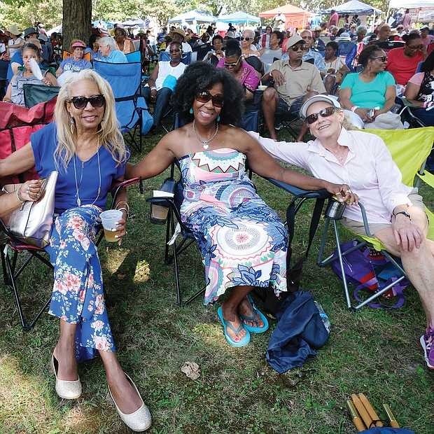 Music for the spirit. Hundreds turned out for the 11th Annual St. Elizabeth Catholic Church Jazz & Food Festival, a fundraiser held last Saturday for the Highland Park parish and its various ministries. Location: The park beside the church on 2nd Avenue. Friends, from left, S.R. Jeffers, Vanessa Raines and Diana Joaquin settle in to enjoy the sounds of local musicians, including the legendary Doc Branch and the Keynotes. (Sandra Sellars/Richmond Free Press)
