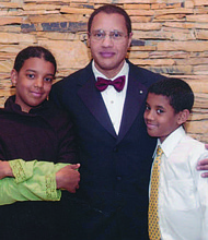 Dr. Carl Bell (middle) with his two children, Briatta (left) and William (right). Photo Credit: Provided by Tyra Taylor-Bell