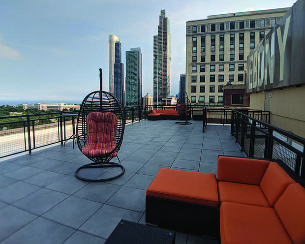Through a door on the top floor of the transformed high-rise at 820 S. Michigan Ave., residents can look out at Lake Michigan and the museum campus as they sit under the historic Ebony and Jet signs that are affixed to the top of the building. Photo Credit: 3L Realty