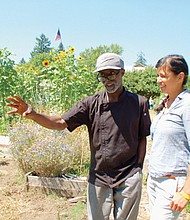 Charles Robertson (left) and Kris Soebroto help run Village Gardens, a non-profit community garden and grocery store in north Portland aimed at connecting low income and diverse communities to fresh, healthy food.