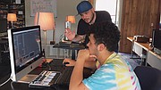 """Teen music producer Raymond Battaro receives instruction from Grant Burgess at a digital music workstation at """"Midschool,"""" a new music education program in historic downtown Gresham that offers low cost and inclusive classes."""