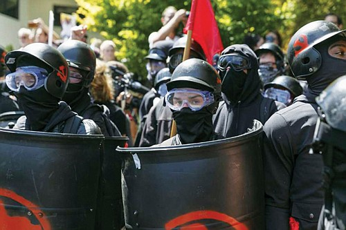 Counter-protesters prepare to clash with Patriot Prayer protesters during an Aug. 4, 2018 rally in Portland, Since President Donald Trump's election, the city has become a political arena for far-right and far-left groups to face off.  (AP photo)