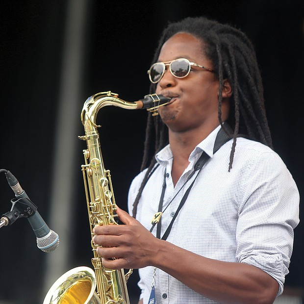 The saxophonist from the Richmond- based brass ensemble Brunswick blows during a number on Saturday at the 10th Annual Richmond Jazz and Music Festival at Maymont.