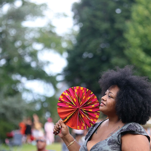 A fan with a fan at the 10th Annual Richmond Jazz and Music Festival at Maymont