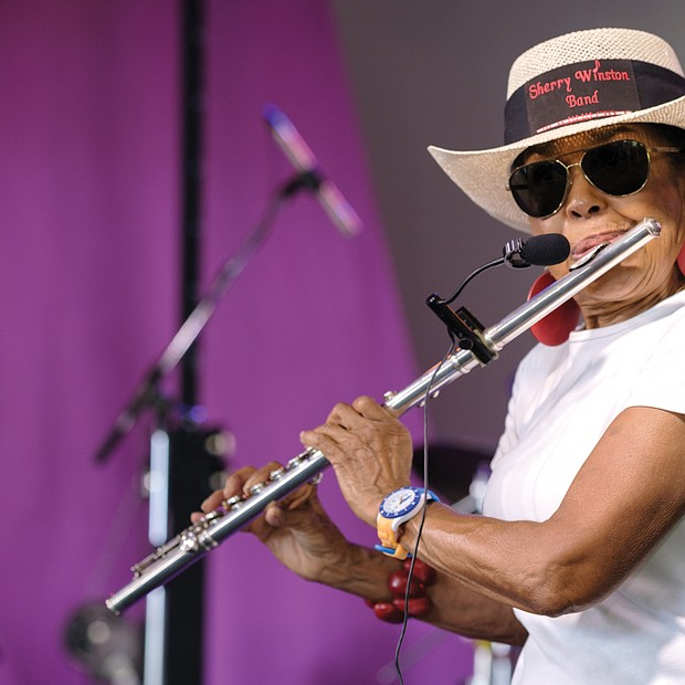 Sherry Winston, who has played the flute since age 11, gets into a mellow groove on Sunday at the 10th Annual Richmond Jazz and Music Festival at Maymont.