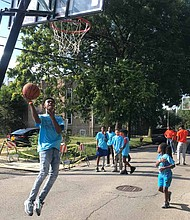 Throughout the summer, neighborhoods across Chicago have been hosting weekly neighborhood basketball games through LISC Chicago's Hoops in the Hood program. Photo Credit: Katherine Newman