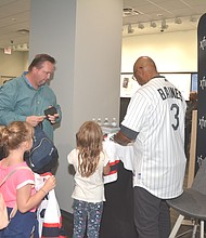 Young Fans of Baseball Hall of Famer Harold Baines signs autographs