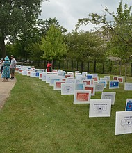 Signs lined the lawn bearing the names of Fallen Firefighters