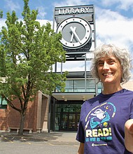 Shannon Long, Multnomah County Library programming assistant, welcomes kids for free lunches as part of a summertime Meals 4 Kids program at the county library system's Midland location near Southeast Stark Street and 122nd Avenue, one of 15 locations served by the new program.