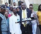 Civil Rights Attorney Benjamin Crump and Baytown, Texas beating victim Kedrick Crawford at press conference held at Harris County Civil Courthouse in Houston, Texas.