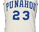 This photo released by Heritage Auctions shows a Punahou School basketball jersey reportedly worn by former President Barack Obama during his student days at the school in Honolulu, Hawaii.