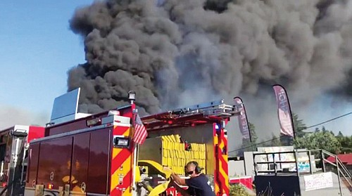 A still frame from KATU video shows fire crews responding to a 4-alarm fire late Monday afternoon in the Madison South neighborhood.