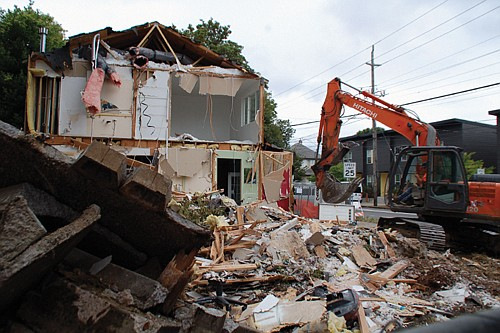 A two-story house at North Vancouver Avenue and Alberta Street that was constructed just 14 years ago but ended up providing office space for the Ernest J. Hill Jr. Insurance Agency was demolished last week to make room for a new 5-unit hotel.