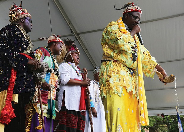Water is poured from an animal horn during a traditional libation ceremony Saturday by representatives of various African nations. (Regina H. Boone/Richmond Free Press)
