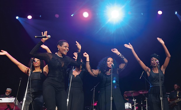 Sounds of Blackness turns up the energy before Common takes the stage at the Hampton Coliseum. (Regina H. Boone/Richmond Free Press)