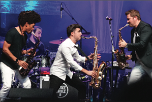 Saxophonists Paul Taylor, Vincent Ingala and Michael Lington of Sax to the Max rock the arena. (photo by Randy Singleton)