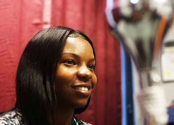 Diamond McGhee's usual wide smile projects confidence. But the smile disappeared last week as she pulled her hair into a ...