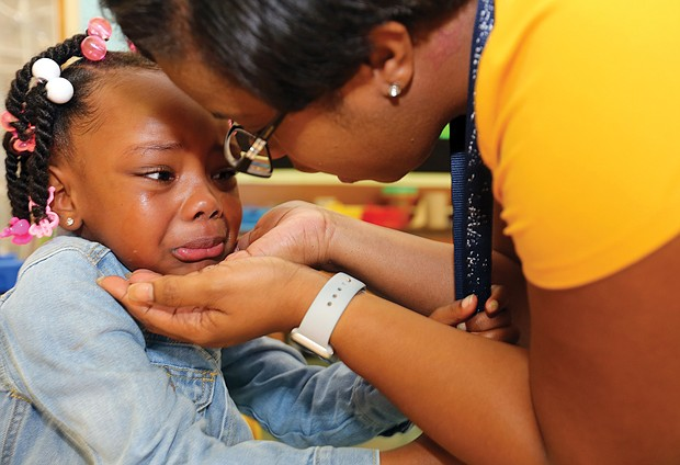 Kindergartner Alonna Smyre, 5, gives her mother, Shartisha White, a tearful goodbye Tuesday as she goes to school for the first time. Her mother said the youngster was excited about starting school at Westover Hills Elementary and claimed she wouldn't be nervous. But once inside, the tears flowed and the hugs got tighter as she didn't want her mom to leave.