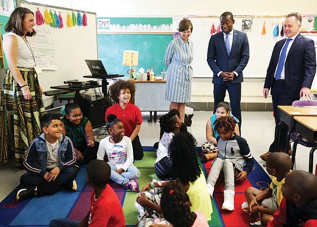 Teacher Abbie Radcliffe, standing at left, and her fourth-grade class at Westover Hills Elementary School welcome Principal Allison El Koubi, Richmond Mayor Levar M. Stoney and Richmond Public Schools Superintendent Jason Kamras on the first day of school.
