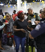 U.S. Customs and Border Protection processing the arrivals of passengers evacuating from the Bahamas in the Port of Palm Beach, Fla.