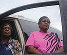 Janice F. Lewis, left, and her sister, Celieto L. Lewis, stand beside their vehicle, which now doubles as their bedroom. The sisters have been homeless since Aug. 23, when the house they were renting was condemned after a kitchen fire.