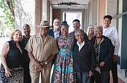 The new director of the Multnomah County Department of Community Justice, Erika Preuitt (center), poses with her family, including her father, Norman Sylvester (to her left) and mother Carmen Sylvester (to her right).