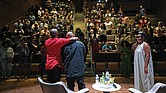 "The audience at the Afrikana Independent Film Festival gives a standing ovation last Saturday to Raymond Santana, center, after the screening of the documentary ""The Central Park Five."" Mr. Santana, who was exonerated in the case after spending five years in prison, talked about his experience following the film. He is embraced by Todd Waldo, adviser for the film festival, while moderator Zoe Spencer, a sociology professor at Virginia State University, looks on."