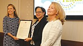 Daily Planet board chair Elizabeth Roark, left, is presented a General Assembly resolution recognizing the Daily Planet's 50 years of service to people in Central Virginia from state Sen. Jennifer McClellan of Richmond. Beth Merchant, chief executive officer of the Daily Planet, right, also participated in the presentation held Aug. 7 at the organization's West Grace Street headquarters.