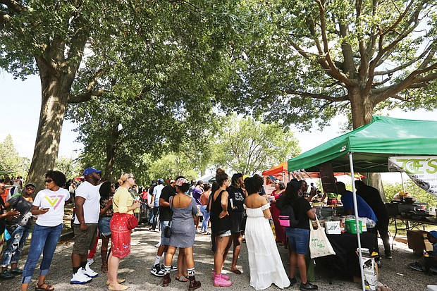 Vegan food for the soul/ Lines were deep during the first Soul Vegan Block Party Sept. 7 at Chimborazo Park in the East End. The free event was designed to promote a healthy and ethically conscious plant-based lifestyle and featured all types of vegan food, juices and products. (Regina H. Boone/Richmond Free Press)