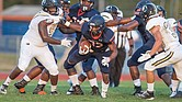 Virginia State University running back Demetrius Strickland rushes the ball down the field during last Saturday's 35-16 victory over the University of North Carolina at Pembroke during the Trojans' first home game.