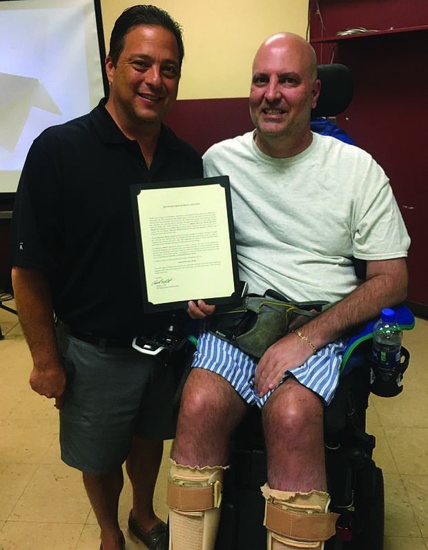 Illinois State Representative Robert Rita (left) recently signed a proclamation recognizing September as Recovery Month and acknowledged the importance of offering substance abuse and addiction recovery services. Photo Credit: Provided by the Office of State Representative Robert Rita