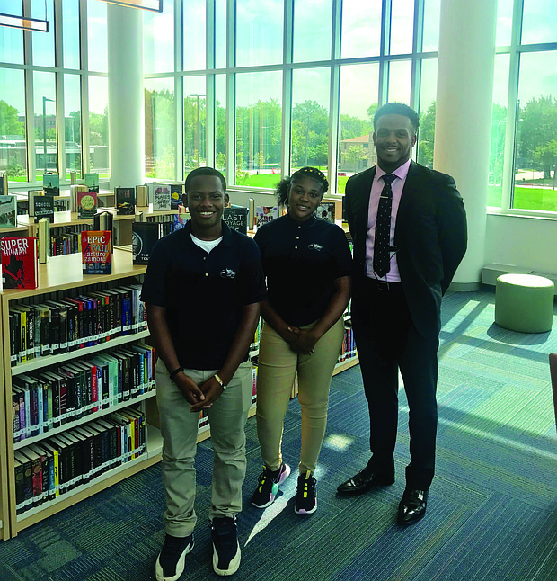 Principal Conrad Timbers-Ausar (right) recently welcomed the first freshman class to attend Englewood STEM High School on their first day of school. Photo Credit: Katherine Newman