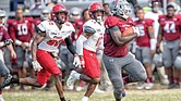 Virginia Union University running back Tabyus Taylor gets past a stunned Winston- Salem State University defense last Saturday at Hovey Field in Richmond.