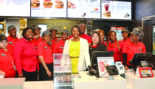 Tonette Williams (center) recently became one of the newest members of the Black McDonald's Operators Association in Chicago after celebrating the opening of her fi rst McDonalds at 207 E. 35th St. in Bronzeville. Photo Credit: Jerome Simmons
