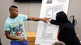 Joshua Brown, left, a neighbor of slain Botham Jean, testifies about the layout of the apartment complex during the murder trial of Amber Guyger in response to questions from Assistant District Attorney LaQuita Long, right. Mr. Brown was shot and killed Oct. 4.