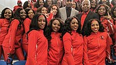 "Popular ESPN sports analyst Stephen A. Smith, above center, poses with Winston-Salem State University Chancellor Elwood Robinson and the Red Sea of Sound after an athletic scholarship was named in Smith's honor. Smith, who graduated from Winston-Salem State in 1991, played basketball under legendary Coach Clarence ""Big House"" Gaines."