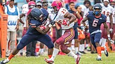 Virginia State University sophomore defensive lineman Javon Frazier takes down Shaw University running back Sidney Gibbs during last Saturday's game at Rogers Stadium in Ettrick. Shaw's offense was minimized, with VSU scoring a 35-0 victory.
