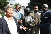 Relatives of Virginia Estelle Randolph, a noted educator in Henrico County who was named the first Jeanes Foundation Supervising Industrial Teacher in the United States, stand around her bronze statue after Monday's ceremony. They are, from left, Henrietta McMickens of Richmond, Ms. Randolph's great-niece; Nelson Randolph Lawson of Richmond, Ms. Randolph's adopted nephew; and Willie Dean Jr. of Schenectady, N.Y., Ms. Randolph's great-great-nephew; and Michael Davis of Richmond, Ms. Randolph's great-great-great-nephew.