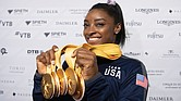 U.S. gymnast Simone Biles shows off the five gold medals she won at the Gymnastics World Championships in Stuttgart, Germany, making her the world's most decorated gymnast with a cumulative 25 medals.
