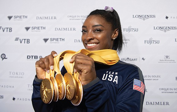 American Simone Biles became the most decorated gymnast in world championship history Sunday when she won the beam and floor ...