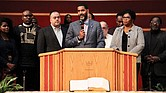 The Rev. Otis Moss III, center, is surrounded by other Chicago church leaders and denomination officials with the United Church of Christ to announce on Oct. 20 that the group paid off $5.3 million in medical debt for poor people in Illinois.