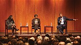 "Author Ta-Nehisi Coates makes a point during his talk Oct. 25 at the Virginia Museum of History & Culture. Other speakers on the panel for ""Legacies of Emancipation,"" are Dr. Manisha Sinha, left, of the University of Connecticut, and Christy Coleman, chief executive officer of the American Civil War Museum."
