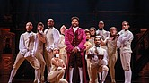 "Actor Bryson Bruce, center, gets into the role of Thomas Jefferson in the national touring company of the hit musical ""Hamilton."""