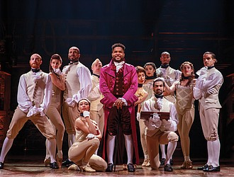 """Actor Bryson Bruce, center, gets into the role of Thomas Jefferson in the national touring company of the hit musical """"Hamilton."""""""