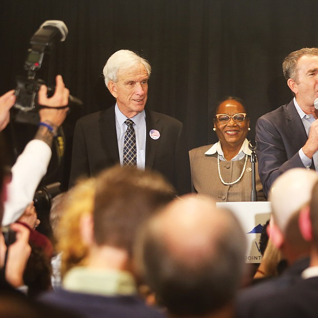 Gov. Ralph S. Northam, center, takes the stage with other Democrats on Election Night at a Downtown hotel, where the party celebrated its big political victory.