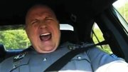 "Dashcam video shows Dover, Delaware Police Master Cpl. Jeff Davis cruising in his vehicle and grooving to Taylor Swift's ""Shake it Off."" The video was an instant hit when released Friday, Jan 16, 2015."