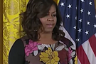 During a speech addressing veteran homelessness, First Lady Michelle Obama echoes her husband's call to come together as a nation.