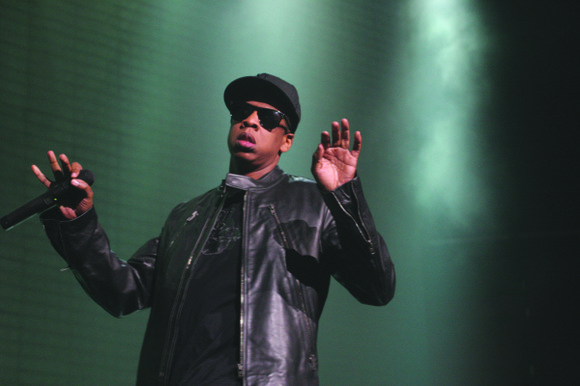 Much attention was paid to the glistening, coaster-sized medallion hanging from rap mogul Jay Z's neck as he and his ...
