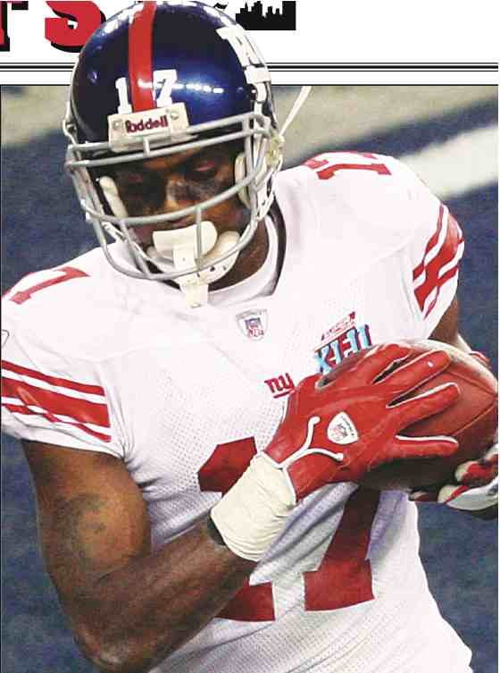 Plaxico Burress, one of the Giants many heroes on their champi-  onship team, caught the winning touchdown in the team's Super  win over the Patriots. Plax is now facing criminal charges for  carrying an unlicensed weapon. (Vern Verna photo)