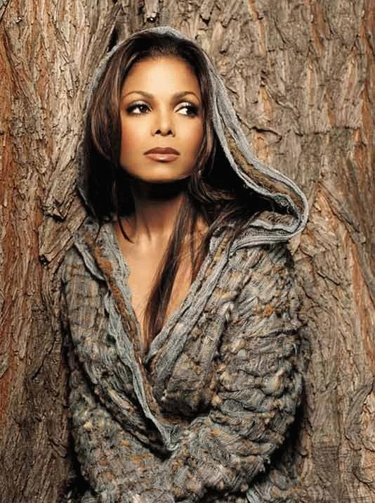 Music icon and legend Janet Jackson in concert at the Essence Music Festival stands to...